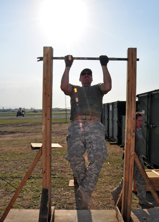 Army Sergeant Michael St. Jean, 1st Battalion, 228th Regiment, cranks out a set of pull-ups in between missions March 26 at Toussaint Louverture International Airport, Haiti. Members of Joint Task Force-Bravo deployed March 21 in support of Joint Task Force-Haiti, the U.S. military's task force assisting in disaster relief efforts in Haiti following the Jan. 12 earthquake as part of Operation Unified Response. (U.S. Air force photo/Staff Sgt. Bryan Franks)
