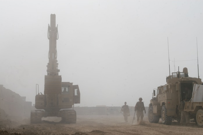 Marines go about digging trenches and enforcing walls at Forward Operating Base Marjah, March 30. The construction of the base began in early March and serves as a key center of operations within the city of Marjah, Afghanistan.
