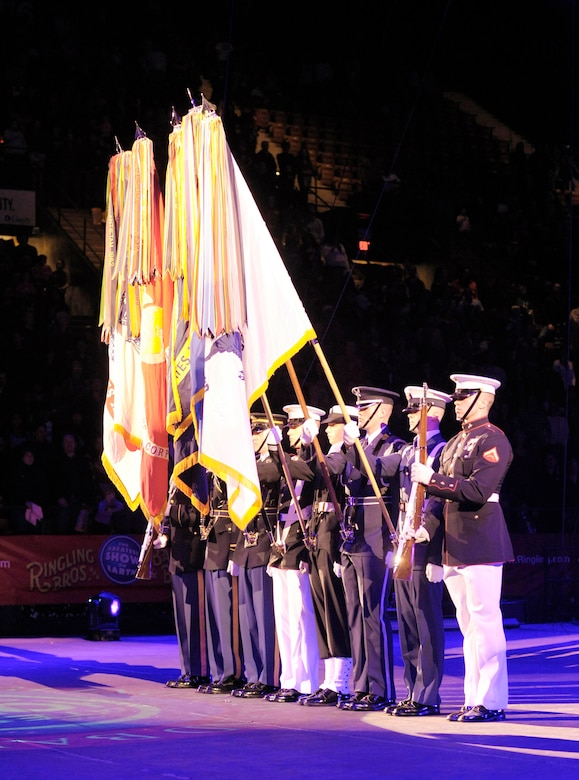 "The Military District of Washington's Joint Color Guard present the flags at the beginning of the Ringling Bros. and Barnum & Bailey ""Zing Zang Zoom"" circus performance March 26, 2010, at George Mason University's Patriot Center in Fairfax, Va. This particular performance was in honor of military families worldwide.  (U.S. Air Force photo/Jim Varhegyi)"