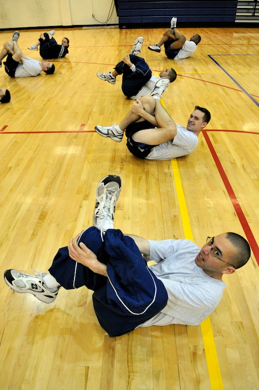 BUCKLEY AIR FORCE BASE, Colo. -- Senior Airman Jose Marinelarena, 460th Operations Support Squadron, stretches during physical training at Buckley Airman Leadership School March 22. ALS trains today's Airmen to become tomorrow's leaders. (U.S. Air Force photo by Senior Airman Kathrine McDowell)