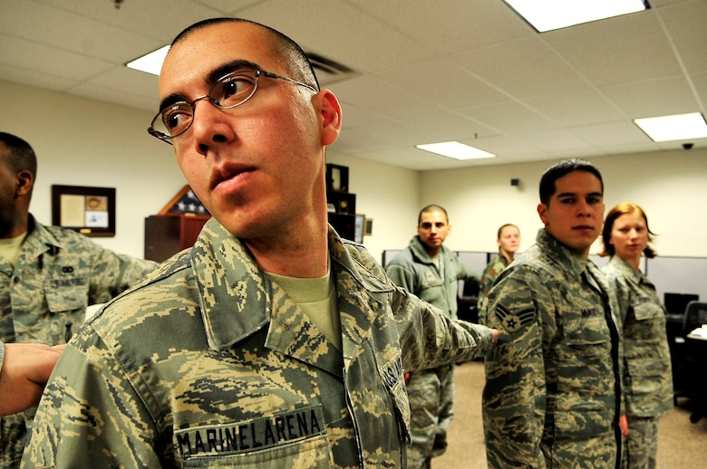 BUCKLEY AIR FORCE BASE, Colo. -- Senior Airman Jose Marinelarena, 460th Operations Support Squadron, practices indoor drill during his first day at Buckley Airmen Leadership School, Feb. 22. ALS trains today's Airmen to become tomorrow's leaders. (U.S. Air Force photo/Senior Airman Kathrine McDowell)