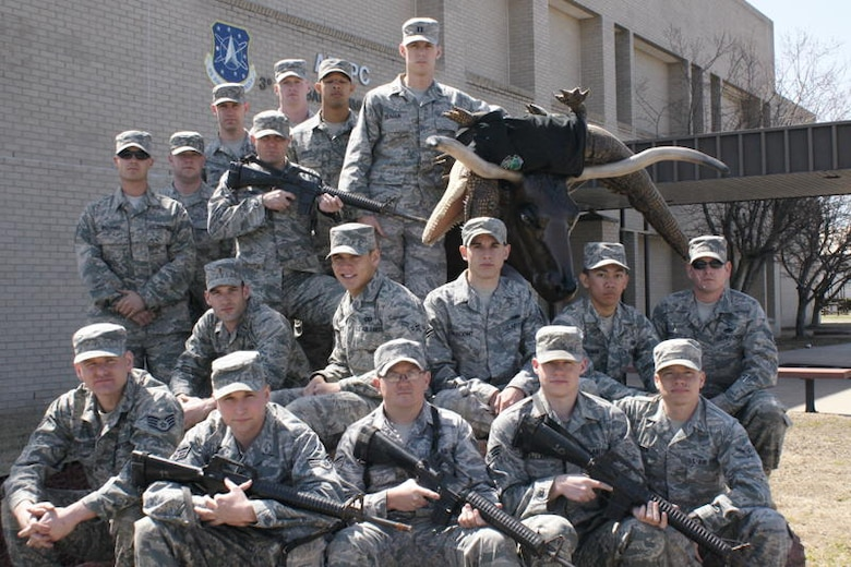 The 3rd Combat Communications Group Guardian Challenge Combat Challenge primary and alternate team members are from bottom row, left to right:  Staff Sgt. David Pattison, Senior Airman Joseph Witkiewicz, Staff Sgt. Adam Benton, Senior Airman David Allen and Airman David Linden. Middle row from left to right:  2nd Lt Kenneth Sturgis, Airmen 1st Class Robert Schuster, Joey Pregont and Nikki Licuanan, and Staff Sgt. Antonio Carrasco. Top row from left to right:  Staff Sgt. Jarod Williams, Senior Airmen Charles Martin and Zachary Skow, Airman 1st Class Benjamin Fleming, Senior Airman Brandon Thompson, A1C Teverence Davis, Capt. Pat Reagan, Buford the Bull. Not pictured:  Staff Sgt. Mathew McCauley (US Air Force photo)