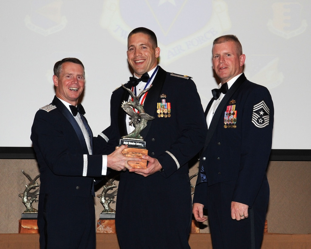 DAVIS-MONTHAN AIR FORCE BASE, Ariz. -- Lt. Gen. Glenn Spears (left), 12th Air Force (Air Forces Southern) commander, and Chief Master Sgt. Harold Clark (right), 12th AF (AFSOUTH) command chief, present the Outstanding Performer of the Year award to Maj. Brandon Sokora Mar. 9. Major Sokora is from the 820th Red Horse Squadron, Nellis Air Force Base, Nev.  (U.S. Air Force Photo by Airman Jerilyn Quintanilla)