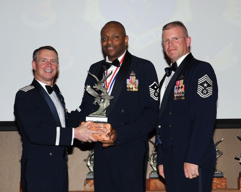 DAVIS-MONTHAN AIR FORCE BASE, Ariz. -- Lt. Gen. Glenn Spears (left), 12th Air Force (Air Forces Southern) commander, and Chief Master Sgt. Harold Clark (right), 12th AF (AFSOUTH) command chief, present the Outstanding Performer of the Year award to Master Sgt. Darryl Ross Mar. 9. Sergeant Ross is from the 366th Fighter Wing, Mountain Home Air Force Base, Id.  (U.S. Air Force Photo by Airman Jerilyn Quintanilla)