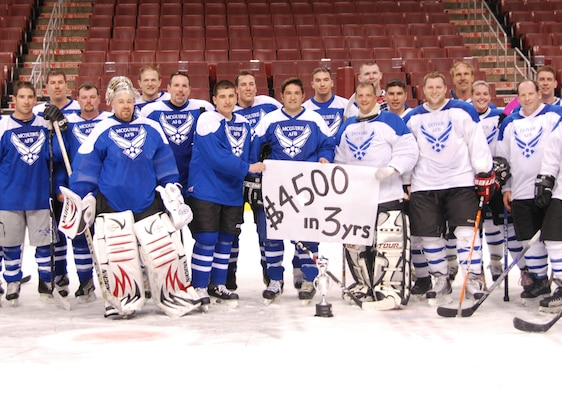 JOINT BASE MCGUIRE-DIX-LAKEHURST, N.J. -- Members of Dover Air Force Base and Joint Base McGuire-Dix-Lakehurst All-Stars ice hockey teams raised $4,500 over the past three years competing in a fundraiser charity match that supports military families in need. Proceeds of the match are donated to the Combined Federal Campaign and Air Force Assistance Fund This year's competition was held March 28 at the Wachovia Center in Philadelphia, PA., with JB MDL's 8-6 win ending the tiebreaker. (U.S. Air Force photo by/Master Sgt. Donna T. Jeffries)