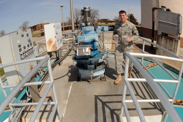 WHITEMAN AIR FORCE BASE, Mo. - Airman 1st Class Jayson Eddelman, 509th Civil Engineer Squadron water treatment plant operator, brings back water samples from around the plant to the water testing lab for the 12 p.m. testing, March 29, 2010. The water treatment plant here goes beyond what Missouri Department of Natural Resources requires by conducting more than 340 tests each day, ensuring the highest quality water for Team Whiteman. (U.S. Air Force photo/ Airman 1st Class Carlin Leslie)  (Released)