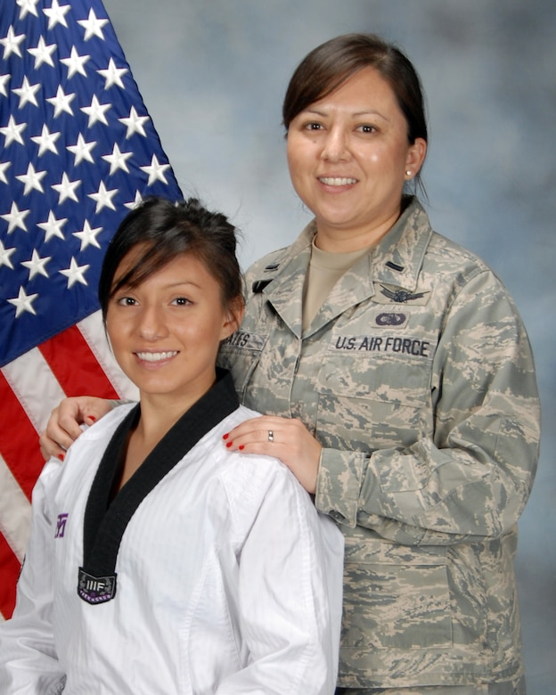 Pictured are Jessie Bates and her mother, Lt. Lynette Bates, Space Based Infrared Systems Wing. Jessie is one of three Americas who qualified to represent the U.S at the Youth Olympics in Taekwondo.  The games will be held in August in Singapore.(Photo by Jim Gordon)
