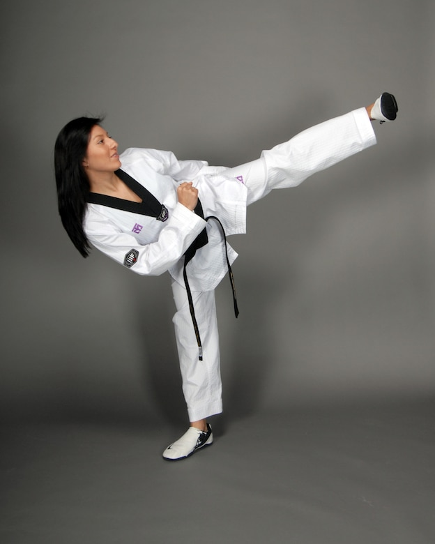 Family Member Jessie Bates demonstrates her Taekwondo skills. The 16-year old has been selected to represent the U.S. in Singapore at the Youth Olympics. The games will be held in August. (Photo by Jim Gordon)