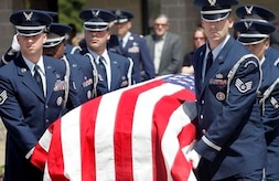 Airmen carry the remains of Air Force Maj. Curtis Daniel Miller on Monday, March 29 in Dallas. Maj. Miller, of Palacios, Texas, was buried Monday afternoon at Dallas-Fort Worth National Cemetery, with full military honors. His funeral comes 38 years to the day after his gunship was shot out of the sky over Laos during the Vietnam War. His remains were processed at the Air Force Mortuary Affairs Operations Center at Dover Air Force Base, Del. (AP Photo/Mike Fuentes)