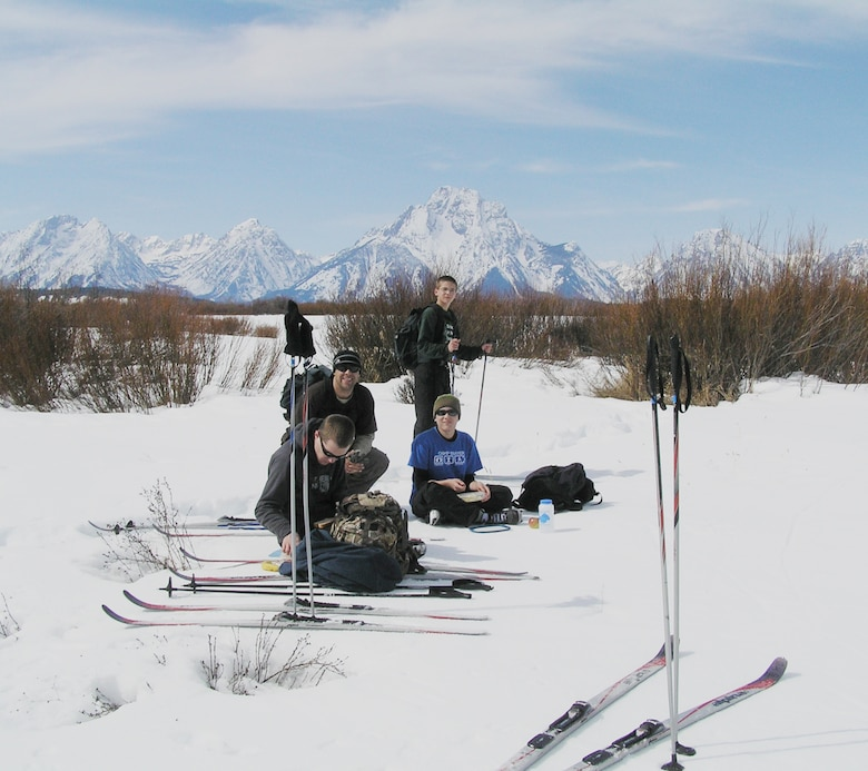 Capt. Gregory Izdepski (center) and his family, Brent Wyatt (front), Jessica Wyatt (center right) and Alec Wyatt (back) take a lunch break in the Grand Teton National Park during Operation Purple Military Family Retreat March 20 in Jackson, Wyo. The camp, sponsored by National Military Family Association, is free and designed for families to reconnect after a parent has been deployed. (Courtesy photo)