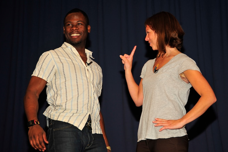 "Performers Kyle Terry, left, and Amber Kelly, right, portray a dating scene during the ""Sex Signals"" presentation at the Hurlburt Field Commando Auditorium March 29.  ""Sex Signals"" is an improvised, two-person presentation geared to educate Airmen about the stereotypes and misconceptions surrounding sexual assault. (U.S. Air Force photo by Senior Airman Matthew Loken)"