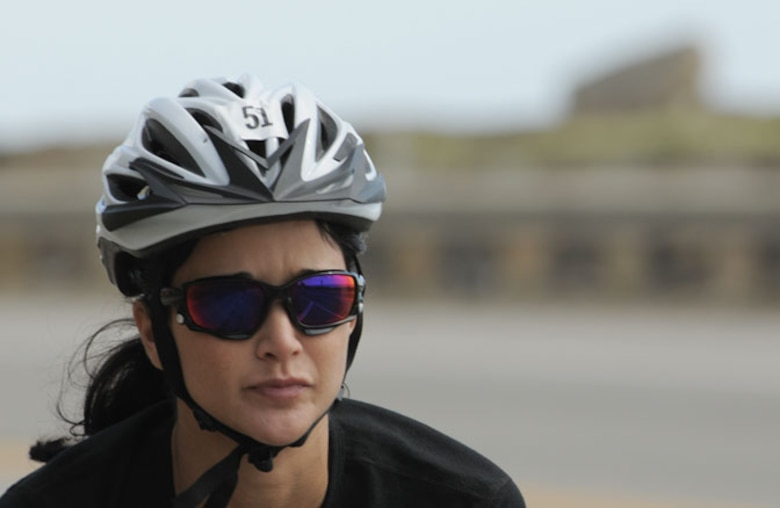 Triathlete Capt. Linda Baltes of the 146th Medical Group works in her cycle training on the Pacific Coast Highway. Baltes is an accomplished triathlete training an upcoming mini-Iron Man, which consists of a mere 1.2 miles of swimming, 56 miles of biking and 13 miles of running.