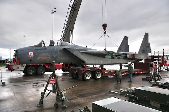 A 1973 A-model F15 the oldest in the Air Force inventory, gets loaded onto a trailer to be transported to the Evergreen Aviation Museum in McMinnville Oregon on April 29th 2010 at the Portland Air National Guard base, Portland Oregon. It will then be reassembled there and put on display. (Photo by Tech Sergeant Dave Huber USAF)