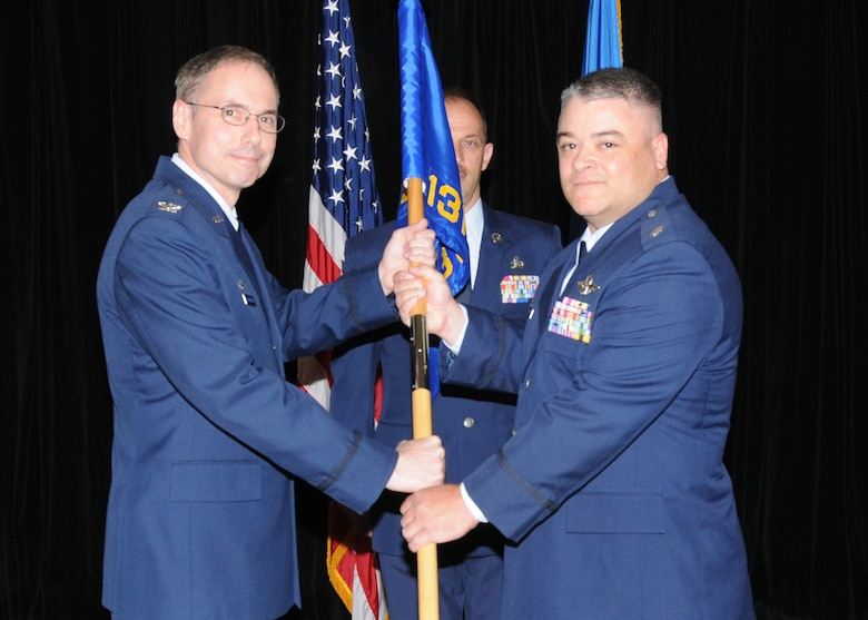 Lt. Col. Ken Eaves receives the guidon and assumes the role of the Operations Group commander from Col. Gregory Champagne, 131st Bomb Wing commander, during a change of command ceremony at Whiteman Air Force Base, May 2. (Photo by Master Sgt. Mary-Dale Amison)