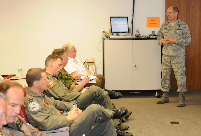 Lt. Col. Dan Grimwood, 162nd Aircraft Maintenance Squadron commander, briefs a team of Dutch airmen and Arizona Air Guardsmen on maintenance and logistics issues associated with bringing Royal Netherlands Air Force F-16 pilot training back to Tucson International Airport, April 27. (Air Force photo by Maj. Gabe Johnson)