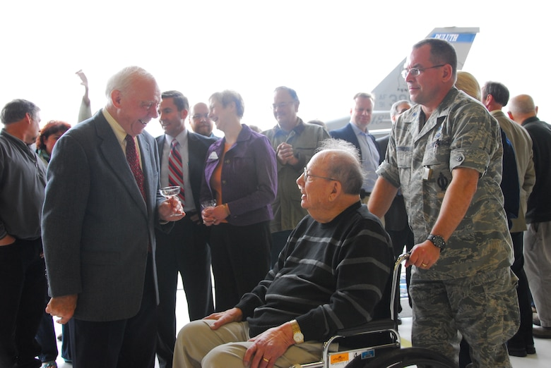 U.S. Rep. James Oberstar speaks with retired U.S. Air Force Col. John R. Hed, first 148th Fighter Wing commander, at a wing celebration ceremony at the Duluth, Minn., ANG Base April 30, 2010.  Past and present members of the unit, friends and family, along with state and local officials gathered at the wing to celebrate the arrival of the new block 50 F-16C aircraft. (U.S. Air Force photo by Master Sgt. Jason W. Rolfe/Released)