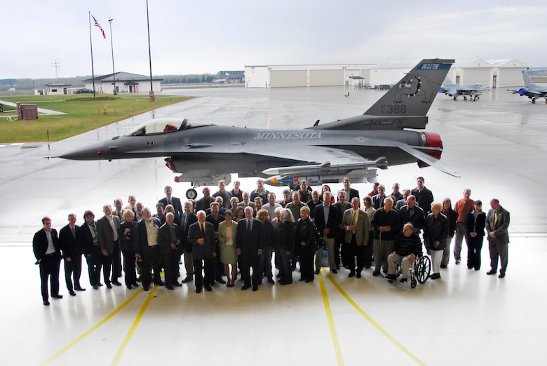 Distinguished guests of the 148th Fighter Wing pose in front of one of the wing's new F-16C Fighting Falcons at a wing celebration ceremony at the Duluth, Minn., ANG Base Apr. 30, 2010.  Past and present members of the unit, friends and family, along with state and local officials gathered at the wing to celebrate the arrival of the new block 50 F-16C aircraft. (U.S. Air Force photo by Master Sgt. Jason W. Rolfe/Released)