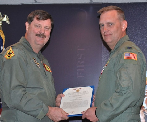Col. William Mason, pictured with Col. Gregory Gilmour, is presented a