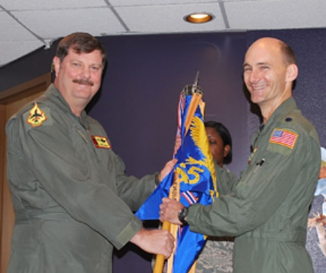 Lt. Col. Thomas Hudnall accepts command of the 465th Air Refueling Squadron on April 10, 2010 from Col. Gregory Gilmour, 507th Operations Group commander.