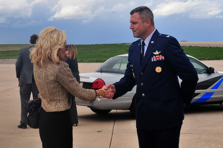 BUCKLEY AIR FORCE BASE, Colo. -- Dr. Jill Biden, the Second Lady, is greeted by Col. Trent Pickering, 460th Space Wing vice commander, before departing from Buckley Air Force Base April 30. Dr. Biden has been an educator for the past 29 years and continues teaching at a DC-area community college. (U.S. Air Force Photo by Airman 1st Class Manisha Vasquez)