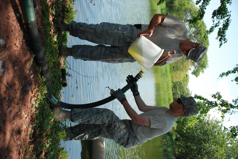 Technical Sgt. William Mock and Staff Sgt. John Seifert, both from Army Forces' Petroleum, Oils and Lubricants Section, pour pond water into a Reverse Osmosis Water Purification Unit during training at Soto Cano Air Base, Honduras, May 4. Instructors from Ft. Lee, Va., are conducting a course here May 3-7, teaching JTF-Bravo members how to operate the ROWPU, which can be used to provide drinkable water from any water source. JTF-Bravo maintains ROWPU capability in order to assist in disaster relief situations where clean drinking water is needed. (U.S. Air Force photo by 1st Lt. Jen Richard)