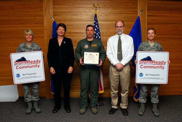 Mr. Michael R. Stewart, meteorologist in charge of the Duluth, Minn., National Weather Service (right center) presents the  148th Fighter Wing with certification as a StormReady Community at the Duluth, Minn., ANG Base May 3, 2010.  The 148th Fighter Wing has become the first National Guard unit to be certified by the National Weather Service as a StormReady Community. (U.S. Air Force photo by Master Sgt. Jason W. Rolfe/Released)