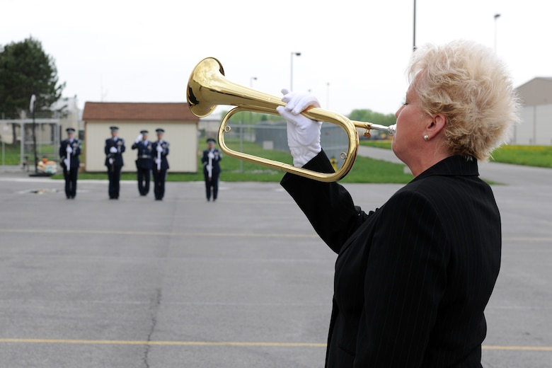 Mrs. Dale Gianetto plays taps while the 174th Fighter Wing Honor Guard firing party renders a salute at a memorial service at Hancock Field in Syracuse, NY on 2 May 2010. The service was to celebrate the life of US Air Force Staff Sgt. Linda Monelavongsy who passed away in a motorcycle accident on 21 April 2010. (US Air Force photo by Staff Sgt. James Faso/Released)