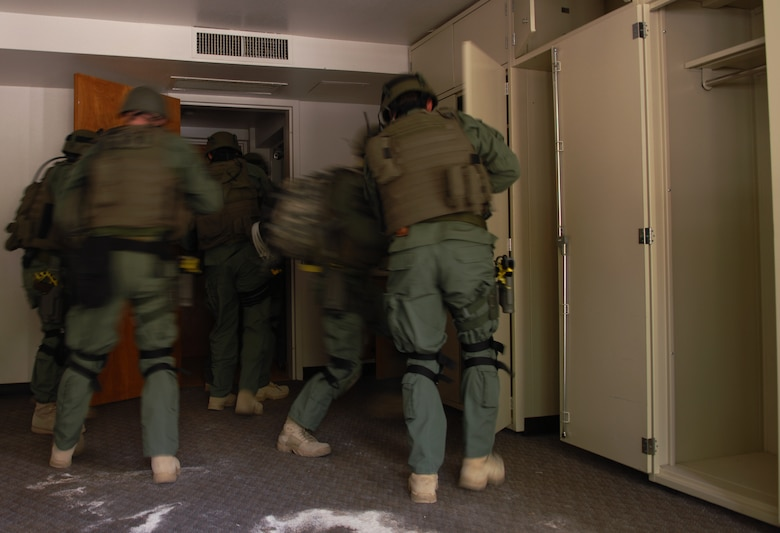 HOLLOMAN AIR FORCE BASE, N.M. -- Members of the El Paso and Albuquerque Federal Bureau of Investigation practice clearing a room during a hostage evercise April 28, 2010, at the base dormitories. The exercise involved 49th SFS Quick Reaction Force members, 49th SFS hostage negotiators; FBI hostage negotiators and FBI Special Weapons and Tactics teams from El Paso, Texas; Las Cruces and Albuquerque, N.M. Within the past year, Holloman security forces and the FBI have begun exercising joint Crisis Negotiation Team training.  This was the first exercise of its kind at Holloman involving both Crisis Negotiation and the SWAT teams. Future exercises are planned and will be larger in scope. (U.S. Air Force photo by Airman 1st Class Joshua Turner / Released)