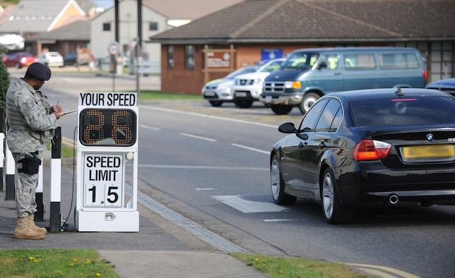 RAF MILDENHALL, England – Staff Sgt. Elvencie Prior, 100th Security Forces Squadron, annotates license plate numbers as vehicles pass a speed camera on RAF Mildenhall April 28. As the weather warms up, and more pedestrians begin to walk, security forces increases its number of speed check points at random times and places on base. (U.S. Air Force photo/ Staff Sgt. Jerry Fleshman)