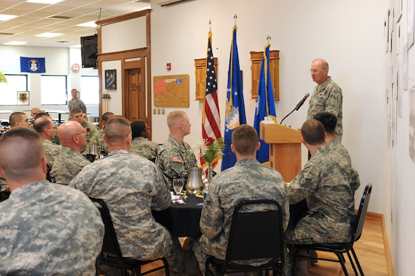 The National Guard Bureau Chief, Gen. Craig R. McKinley gives words of encouragement to members of the New York Air National Guard's 174th Fighter Wing and members of the New York Army National Guard's 27th Brigade at Hancock Field in Syracuse NY on 5 May 2010. McKinley was meeting with members of the New York Air and Army guard at a luncheon to recognize the efforts of the men and women of these organizations. (US Air Force photo by Tech. Sgt. Jeremy M. Call/Released)