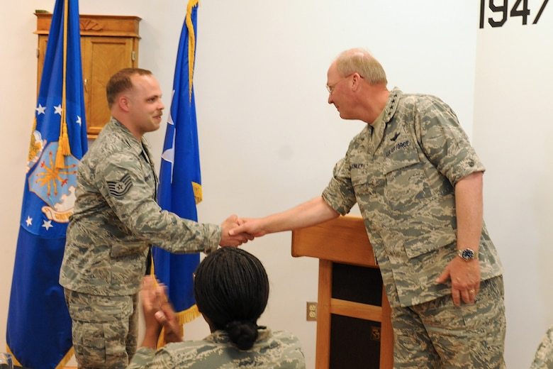 The National Guard Bureau Chief, Gen. Craig R. McKinley presents US Air Force Tech. Sgt. Michael Griepsma with a coin for outstanding work as a Ground Radio technician at Hancock Field in Syracuse NY on 5 May 2010. McKinley was meeting with members of the New York Air and Army guard at a luncheon to recognize the efforts of the men and women of these organizations. (US Air Force photo by Tech. Sgt. Jeremy M. Call/Released)