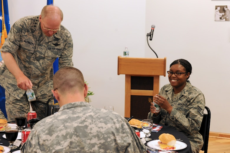 US Air Force Staff Sgt. Takeya A. Williams enjoys her lunch with the National Guard Bureau Chief, Gen. Craig R. McKinley along with members of the New York Air National Guard's 174th Fighter Wing and members of the New York Army National Guard's 27th Brigade at Hancock Field in Syracuse NY on 5 May 2010. McKinley was meeting with members of the New York Air and Army guard at a luncheon to recognize the efforts of the men and women of these organizations. (US Air Force photo by Tech. Sgt. Jeremy M. Call/Released)