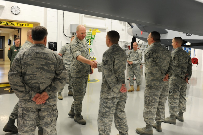 National Guard Bureau Chief, US Air Force General Craig R. McKinley meets with instructors at the Field Training Detachment at Hancock Field in Syracuse, NY on 5 May 2010.  McKinley was getting a tour of the school house responsible for all MQ-9 Reaper Remotely Piloted Aircraft maintenance training for the US Air Force. (US Air Force photo by Tech. Sgt. Jeremy M. Call/Released)