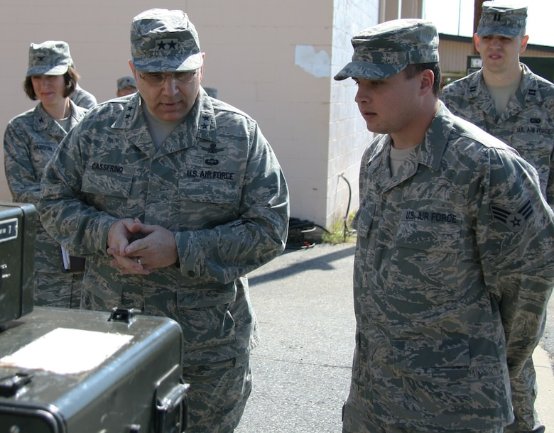 Maj. Gen. Frank Casserino, mobilization assistance to the AF Space Command commander, Peterson Air Force Base, Colo., talks with Senior Airman Bryan Cain, 53rd Combat Communications Squadron, Robins Air Force Base, Ga., about the TRN-26 Tactical Air Navigation System during his visit April 30. (US Air Force photo by 2nd Lt. Joel Cooke)