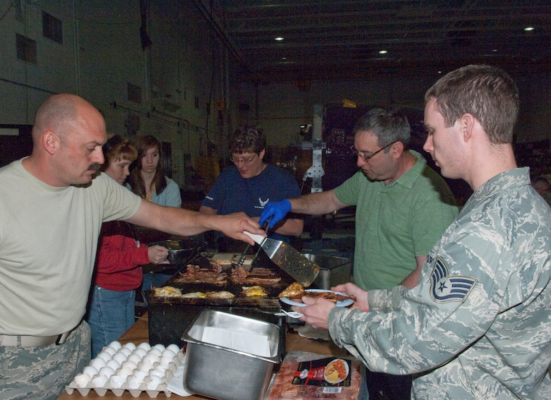 Deployers from the 133rd Airlift Wing enjoy breakfast prepared by co-workers and family members in the early morning hours on May 1, 2010 at the St. Paul Air National Guard base. Airmen departed for duty in Southwest Asia as the Minnesota Air National Guard's C-130 unit takes another turn in the combat zone. USAF photo by Senior Master Sgt. Mark Moss (Released)