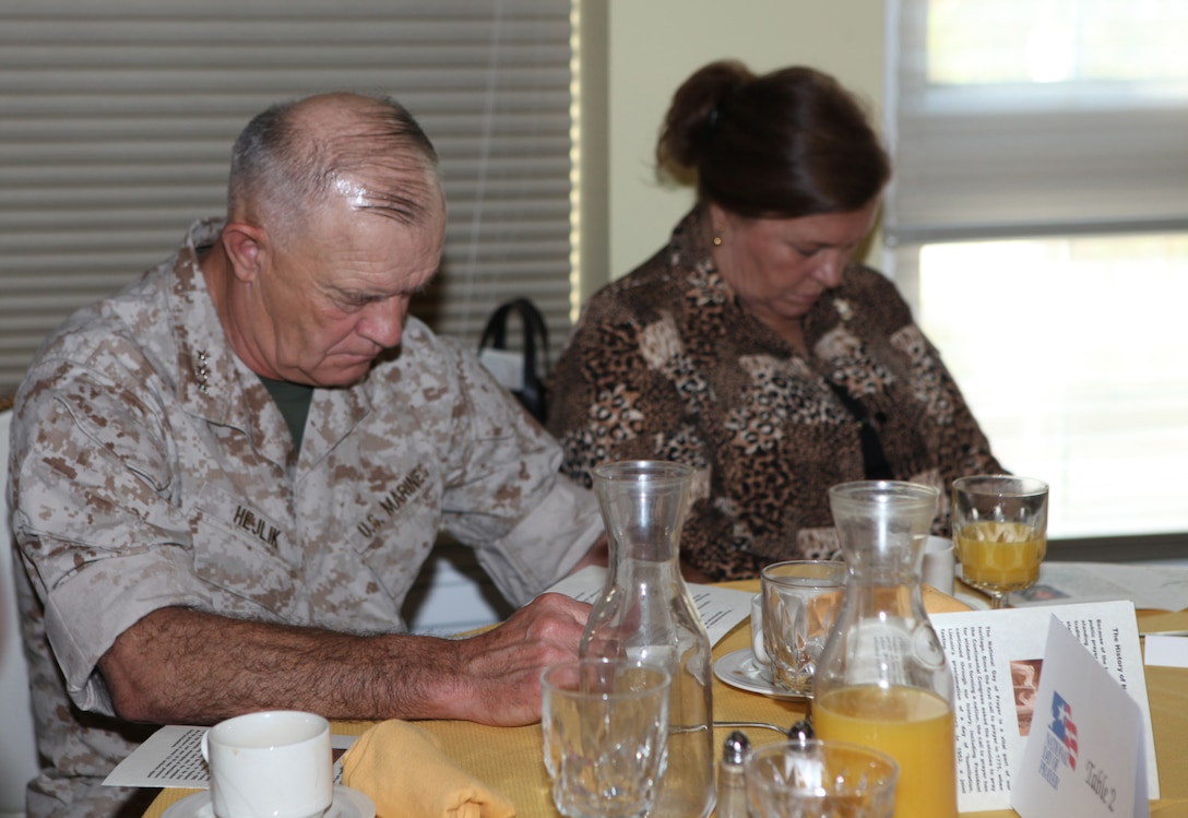 Lt. Gen. Dennis J. Hejlik (left), commanding general of II Marine Expeditionary Force, prays during the National Day of Prayer breakfast at the Paradise Point Officers' Club aboard Marine Corps Base Camp Lejeune, May 6.  The National Day of Prayer was an open invitation and everyone from junior enlisted personnel to general officers attended the event to pay their respects and show support for the nation, its leaders and people.