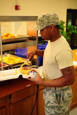 ANDERSEN AIR FORCE BASE, Guam?Airman 1st Class Wendell Gunn performs his daily duties at the Andersen Flight Kitchen, here on May 6, 2010. The Flight Kitchen is a new addition to the 36th Force Support Squadron. It opened June of last year and offers another meal option to team Andersen, especially those working on the flight line. (U.S. Air Force photo by Airman 1st Class Jeffrey Schultze)