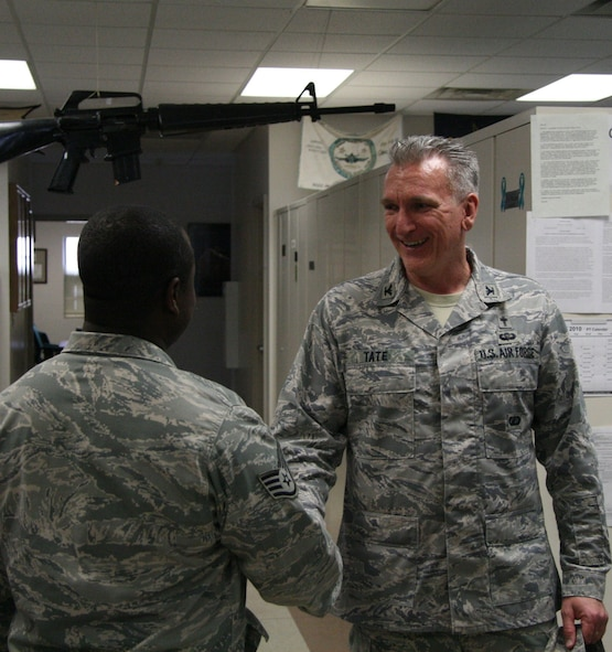 Col. Gregory Tate Air Force Space command chaplain, thanks and shakes hands with Staff Sgt. Brian Thompson, one of the instructors at the 5th Combat Communications Group Combat Readiness School, Robins Air Force Base, Ga. during his visit May 5. (US Air Force photo by 2nd Lt. Joel Cooke)