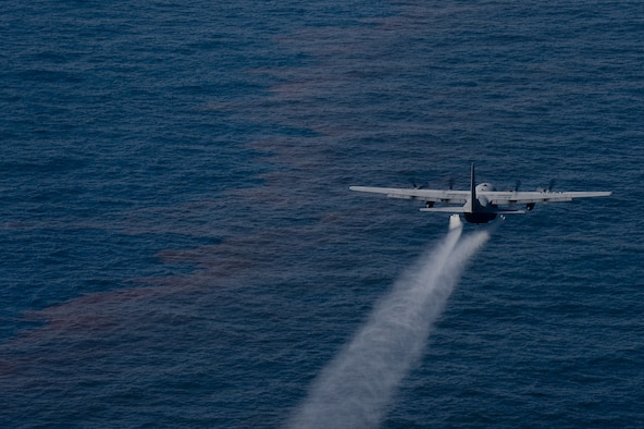 A C-130 aircraft from the 910th Airlift Wing, Youngstown Air Reserve Station, Ohio, drops an oil-dispersing chemical into the Gulf of Mexico as part of the Deepwater Horizon Response effort May 5, 2010. Reservists from the 910th AW are in Mississippi to assist in cleanup efforts. The wing specializes in aerial spray and is the Department of Defense's only large area fixed-wing aerial spray unit. (U.S. Air Force photo/Tech. Sgt. Adrian Cadiz)