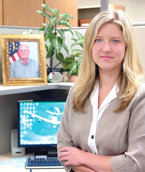 A picture of her father, Kris, adorns Kristy Garriott's workspace. The E-3 engineer with the 327th Aircraft Sustainment Wing, is working at Tinker in the same type of position that her father held for years.(Air Force photo by Margo Wright)