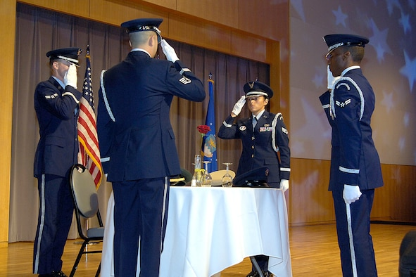 The Tinker Honor Guard performs a solemn POW/MIA table ceremony during a recent Tinker event at the National Cowboy and Western Heritage Museum in Oklahoma City.  Members represent the Air Force, and Tinker, as they honor military members at funerals and care for the flags during numerous events on base and in the community. Pictured clockwise from front are, Staff Sgt. Lawrence Bach, Airman 1st Class Benjamin Powe, Senior Airman Jennifer Stacy and Airman 1st Class Johnathan Flemmer. (Air Force photo by Margo Wright)