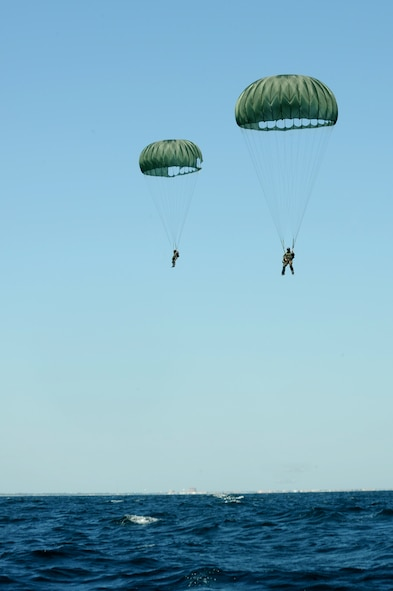A pair of Sailors from U.S. Navy Special Boat Team 20 parachute down to the Gulf of Mexico April 26, 2010 after jumping out of an MC-130H assigned to the 15th Special Operations Squadron at Hurlburt Field. Fla. SBT-20, home-ported at Joint Expeditionary Base Little Creek, Va., and the 15th SOS participated in joint training conducted by the maritime training division of the 1st Special Operations Support Squadron Range Support Flight from Hurlburt Field. (DoD photo by U.S. Air Force Airman Caitlin O'Neil-McKeown)
