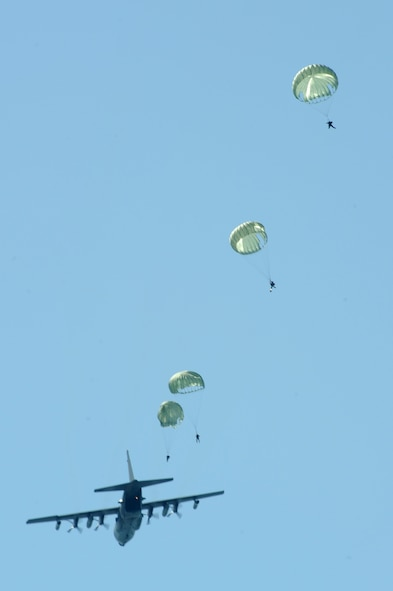 U.S. Navy Special Boat Team 20 members parachute out of an MC-130H assigned to the 15th Special Operations Squadron at Hurlburt Field, Fla., over the Gulf of Mexico April 26, 2010. SBT-20, home-ported at Joint Expeditionary Base Little Creek, Va., and the 15th SOS participated in joint training conducted by the maritime training division of the 1st Special Operations Support Squadron Range Support Flight from Hurlburt Field. (DoD photo by U.S. Air Force Airman Caitlin O'Neil-McKeown)