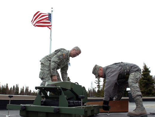 Army Master Sgt. Larry Wiedel, Joint Forces Headquarter-North Carolina communication specialist, and Air Force 1st Lt. Marcus Huneycutt, 263rd Combat Communications Squadron officer in charge, set up a satellite communication dish at the National Guard Armory in Kenai, Alaska, during the Alaska National Guard Vigilant Guard 2010 exercise April 25. Alaska NG VG-2010 is an exercise sponsored by the National Guard Bureau that allows Joint Forces Headquarters, Joint Task Forces and