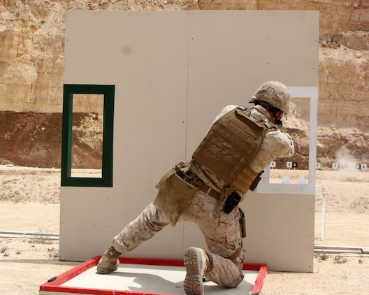 Sgt. Dave Wilson, a team leader with the Force Reconnaissance Platoon from the 24th Marine Expeditionary Unit, participates in a pistol firing competition during the 2nd Annual Warrior Competition held at the King Abdullah II Special Operations Training Centre (KASOTC), Jordan, May 8, 2010.  The Marine Force Recon team took first place after beating 6 other teams in a variety of events that included shooting competitions, rappelling, and obstacle courses.  (Official U.S. Marine Corps photo by Sgt. Alex Sauceda)