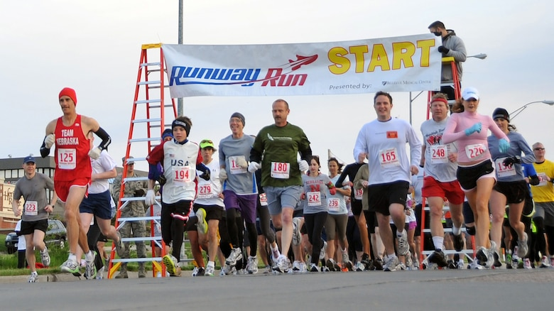 OFFUTT AIR FORCE BASE, Neb. -- More than 140 runners begin the third annual Bellevue-Offutt Runway Run at the Bellevue Welcome Center in Bellevue, Neb., May 9. The seven mile race included about two miles of Offutt's runway. U.S. Air Force Photo by Jeff W. Gates