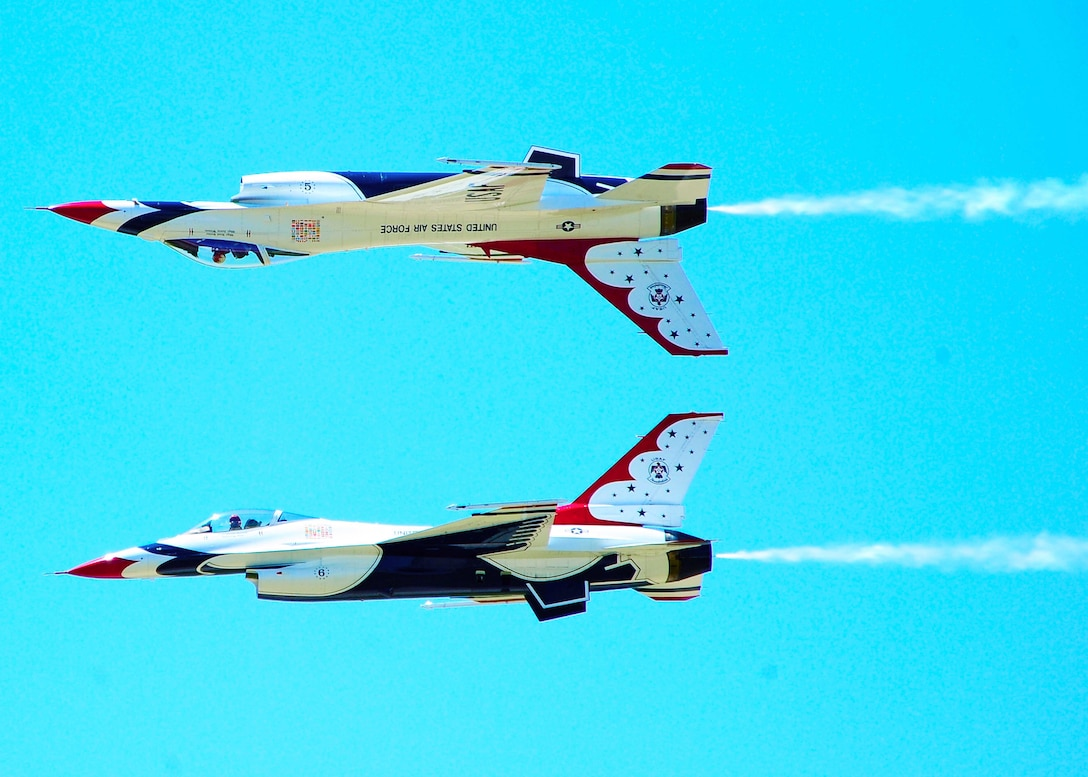 Air Force Thunderbirds lead solo pilot, Maj. Rick Goodman, and Capt. Aaron Jelinek, opposing solo, perform the Calypso Pass during the Dyess Big Country Air Fest May 1, 2010, at Dyess Air Force Base, Texas. (U.S. Air Force photo/Senior Airman Stephen Reyes)