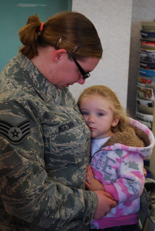 Staff Sgt. Janelle E. Wertman, 42nd Aerial Port Squadron, says goodbye to her three-year-old daughter before leaving for her first deployment.  Sergeant Wertman was one of about 15 aerial porters deploying to support the surge in Afghanistan.  (U.S. Air Force Photo by Tech. Sgt. Andrew Biscoe)
