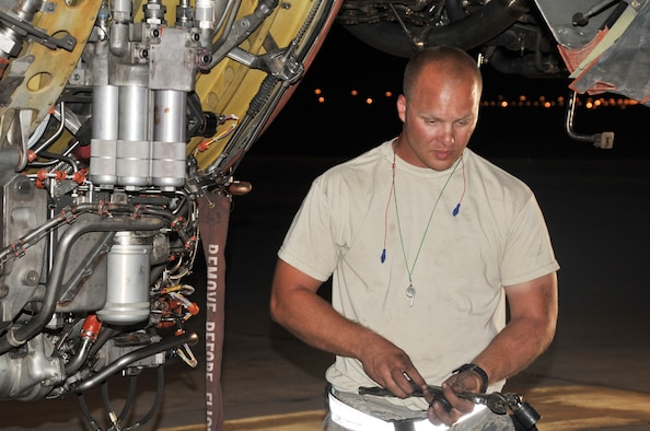 Staff Sgt. Michael Latiolais, KC-10 Extender aerospace maintenance journeyman with the 380th Expeditionary Aircraft Maintenance Squadron's Extender aircraft maintenance unit, works on a KC-10 engine in the evening hours of May 1, 2010, at a non-disclosed base in Southwest Asia.  Sergeant Latiolais is deployed from the 660th Aircraft Maintenance Squadron, 60th Air Mobility Wing, Travis Air Force Base, Calif. His hometown is Saint Martinville, La. (U.S. Air Force Photo/Master Sgt. Scott T. Sturkol/Released)