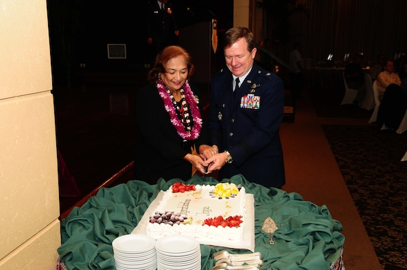 TUMON, Guam - Joyce Martratt, 36th Wing administrative assistant, cuts the ceremonial cake with Brig. Gen. Phil Ruhlman, 36th Wing commander, during her recognition luncheon for her 44 years of civilian service here May 7. Mrs. Martratt was recognized for her outstanding service for the Air Force by friends, family and Team Andersen members. (U.S. Air Force photo by Airman 1st Class Jeffrey Schultze)